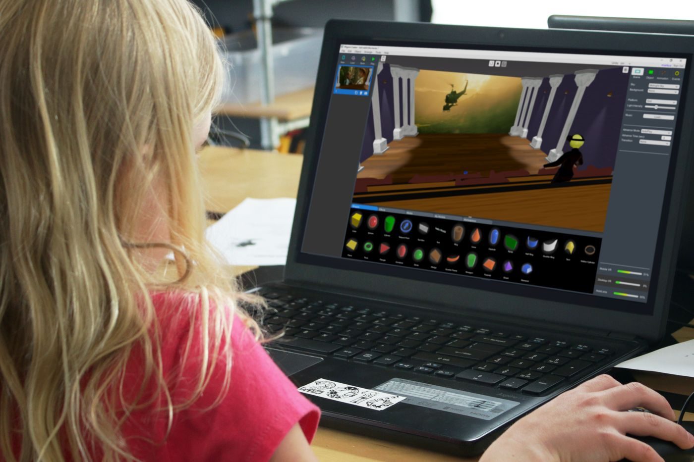 A child using the Builder on a laptop